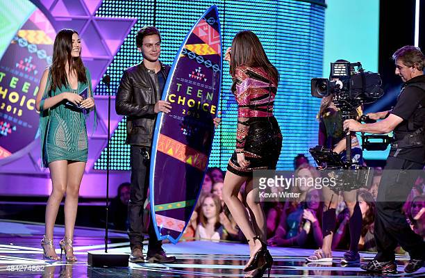Actors Victoria Justice and Jake T Austin present actress Nina Dobrev with the Choice TV Actress Fantasy/SciFi Award for 'Vampire Diaries' onstage...