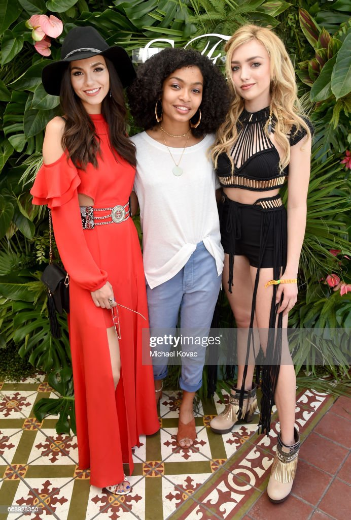 Actors Victoria Justice, Yara Shahidi, and Peyton List attend POPSUGAR and The Council of Fashion Designers of America's (CFDA) Brunch with Designers Emily Current and Meritt Elliott of THE GREAT., and Clare Vivier of Clare V. at the POPSUGAR Cabana Club at Colony Palms Hotel on April 15, 2017 in Palm Springs, California.