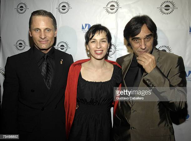 Actors Viggo Mortensen Ariadna Gil and director Agustin Diaz Yanes pose before the screening of Alatriste at the Gusman Theater during the Miami...