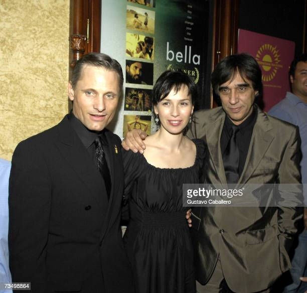 Actors Viggo Mortensen Ariadna Gil and director Agustin Diaz Yanes pose on the red carpet before the screening of Alatriste at the Gusman Theater...