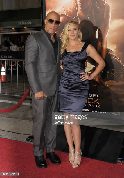 Actors Vin Diesel and Katee Sackhoff arrive at the Los Angeles premiere of 'Riddick' at the Westwood Village Theatre on August 28 2013 in Westwood...