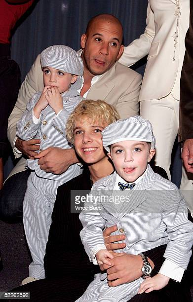 Actors Vin Diesel and Max Thieriot pose with twins Logan and Keegan Hoover at the premiere of Disney's The Pacifier at the El Capitan Theatre on...