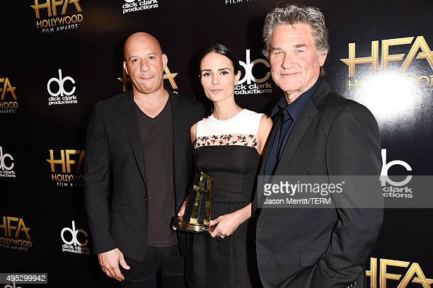 Actors Vin Diesel Jordana Brewster and Kurt Russell pose with the Hollywood Blockbuster Award for 'Furious 7' in the press room during the 19th...