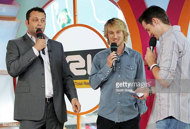 Actors Vince Vaughn and Owen Wilson appear onstage with VJ Damien Fahey during MTV's Total Request Live at the MTV Times Square Studios July 14 2005...