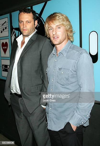 Actors Vince Vaughn and Owen Wilson pose backstage during MTV's Total Request Live at the MTV Times Square Studios July 14 2005 in New York City
