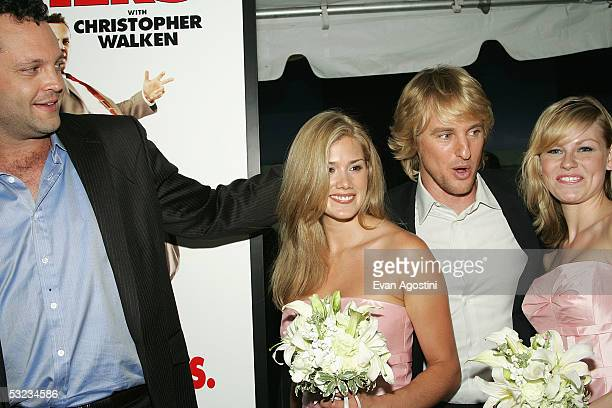 """Actors Vince Vaughn and Owen Wilson pose with """"bridesmaids"""" Heidi Bailey and Amelia Nelson at the premiere of """"Wedding Crashers"""" at the Ziegfeld..."""