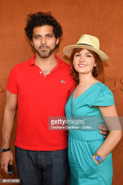 Actors Vincent Heneine and Justine Le Pottier attend the 2018 French Open - Day Five at Roland Garros on May 31, 2018 in Paris, France.