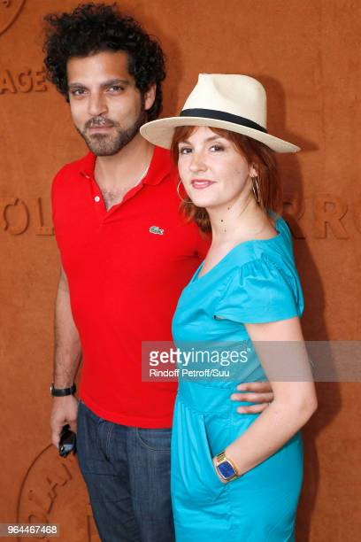 "Actors Vincent Heneine, of ""Engrenage"", and Justine Le Pottier, of ""Scenes de menages"", attend the 2018 French Open - Day Five at Roland Garros on..."