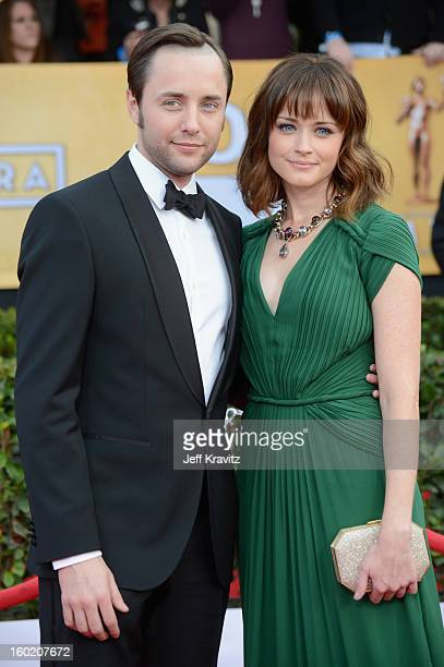 Actors Vincent Kartheiser and Alexis Bledel arrive at the 19th Annual Screen Actors Guild Awards held at The Shrine Auditorium on January 27 2013 in...