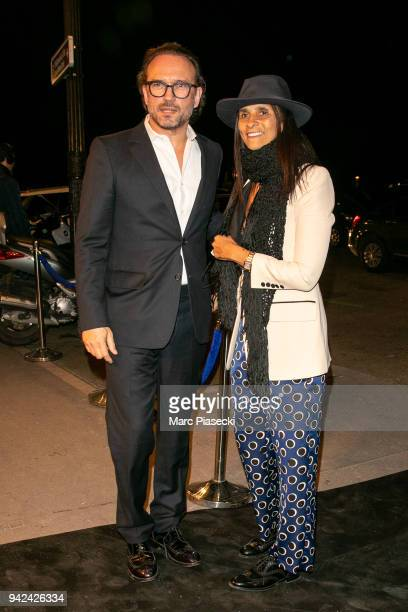 Actors Vincent Perez and Karine Silla arrive to attend the 'Madame Figaro' dinner at Automobile Club de France on April 5 2018 in Paris France