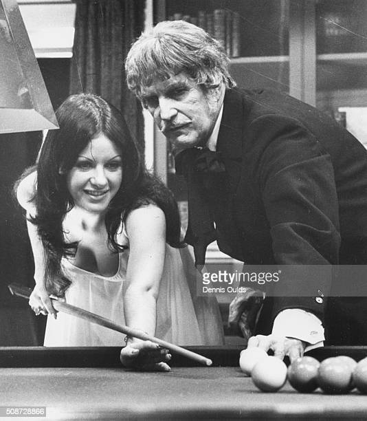 Actors Vincent Price and Valli Kemp playing a game of snooker on the set of the horror film 'Dr Phibes Rises Again' at Elstree Studios, London,...
