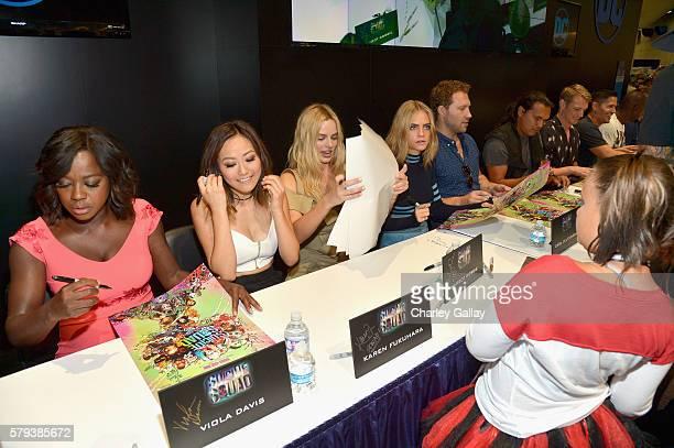 Actors Viola Davis, Karen Fukuhara, Margot Robbie, Cara Delevingne, Jai Courtney, Adam Beach, Joel Kinnaman and Jay Hernandez from the cast of...