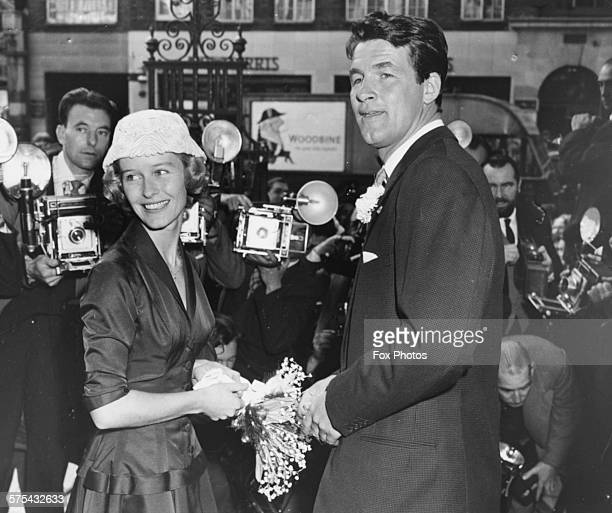 Actors Virginia McKenna and Bill Travers pictured surrounded by press photographers on their wedding day outside Chelsea Registry Office in London...