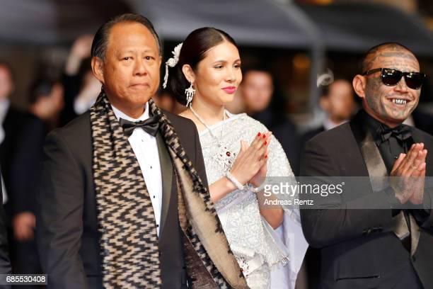 Actors Vithaya Pansringarm Pornchanok Mabklang and Panya Yimumpha attend the A Prayer Before Dawn screening during the 70th annual Cannes Film...