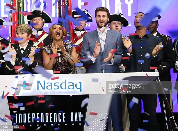 Actors Vivica A Fox Liam Hemsworth and Jessie T Usher attend Independence Day Resurgence Cast Rings The Nasdaq Stock Market Opening Bell at NASDAQ...