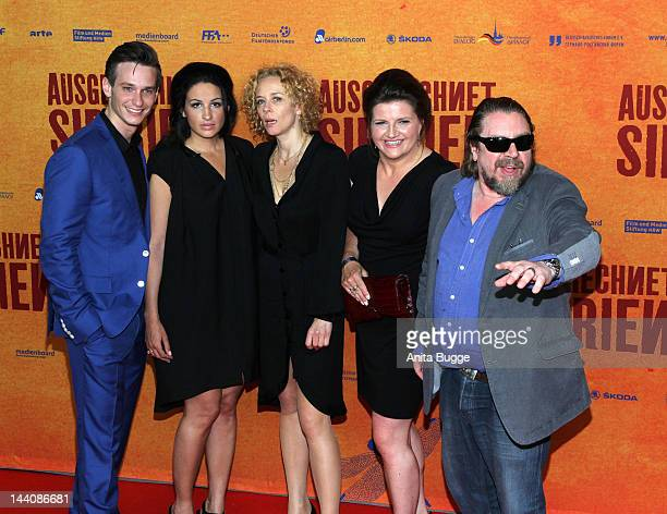 Actors Vladimir Burlakov producer Minu Barati Fischer Katja Riemann Skady Lis and Arnim Rohde attend the Ausgerechnet Sibirien Berlin Premiere at...