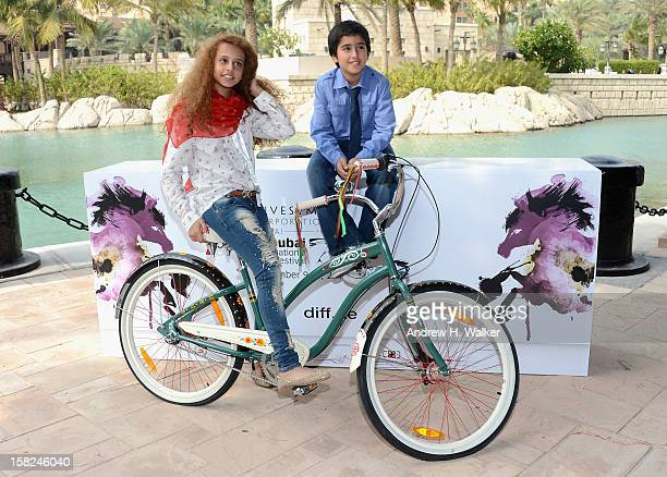 Actors Waad Mohammed and Abdulrahman al Guhani attend the 'Wadjda' photocall during day four of the 9th Annual Dubai International Film Festival held...