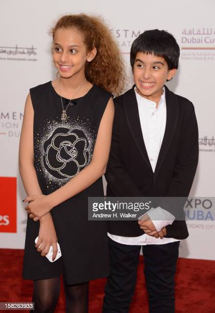Actors Waad Mohammed and Abdulrahman al Guhani attend the Wadjda premiere during day four of the 9th Annual Dubai International Film Festival held at...