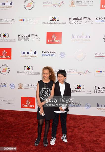 Actors Waad Mohammed and Abdulrahman al Guhani attend the 'Wadjda' premiere during day four of the 9th Annual Dubai International Film Festival held...