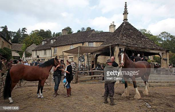 Actors wait for filming to continue on the set of 'War Horse' which is currently being filmed in Castle Combe on September 22 2010 near Chippenham...