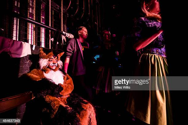 Actors wait stage left during the Puss in Boots pantomime at the Hackney Empire on December 6 2013 in London England