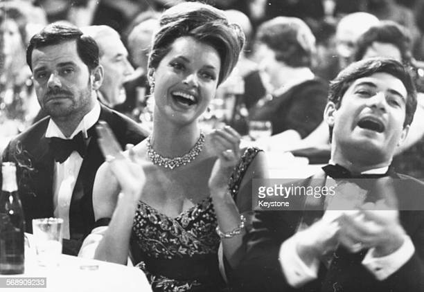 Actors Walter Giller Nadja Tiller and Jean Claude Brialy clapping at an event held by Senator Burda at the Munich Hotel 'Bayrischer Hof' January 17th...