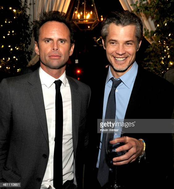 Actors Walton Goggins and Timothy Olyphant pose at the after party for the premiere screening of FX's 'Justified' at RivaBella Restaurant on January...