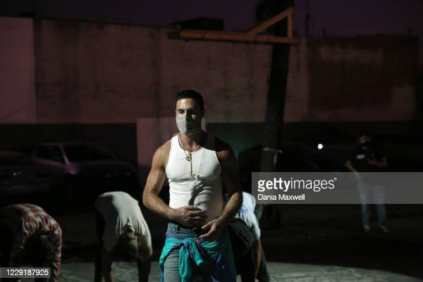 Actors warm up for 5711 Avalon, a Slauson Rec. Theater Company play that explores a drive through COVID-19 testing site in South Los Angeles on...