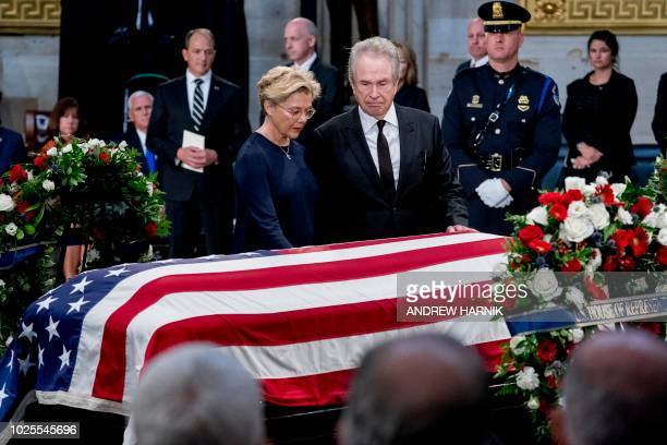 Actors Warren Beatty and wife Annette Bening stand before the flagdraped casket of the late US Senator John McCain in the Rotunda of the US Capitol...