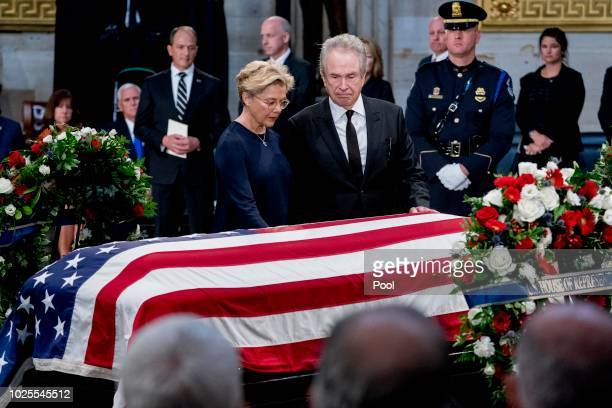 Actors Warren Beatty right and his wife Annette Bening left stand over the casket of Sen John McCain RAriz as he lies in state in the Rotunda of the...