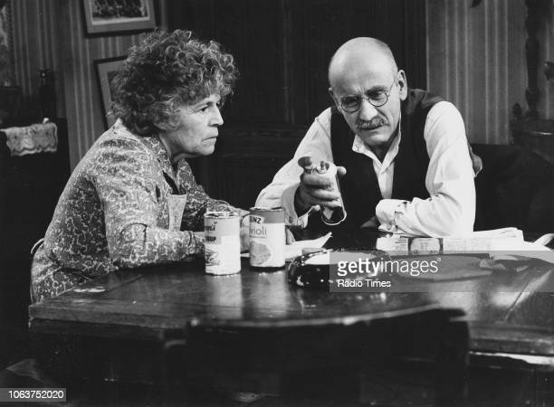 Actors Warren Mitchell and Patricia Hayes sitting at a dining table in an episode of the television show 'Till Death Us Do Part' January 8th 1975