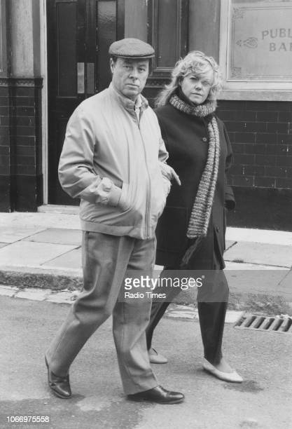 Actors Wendy Richard and Bill Treacher walking on the set of the television soap opera 'EastEnders' October 4th 1985