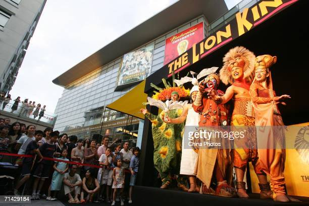 Actors who perform in 'The Lion King' attend a promotion event at the Shanghai New World shopping mall July 12 2006 in Shanghai China The musical...