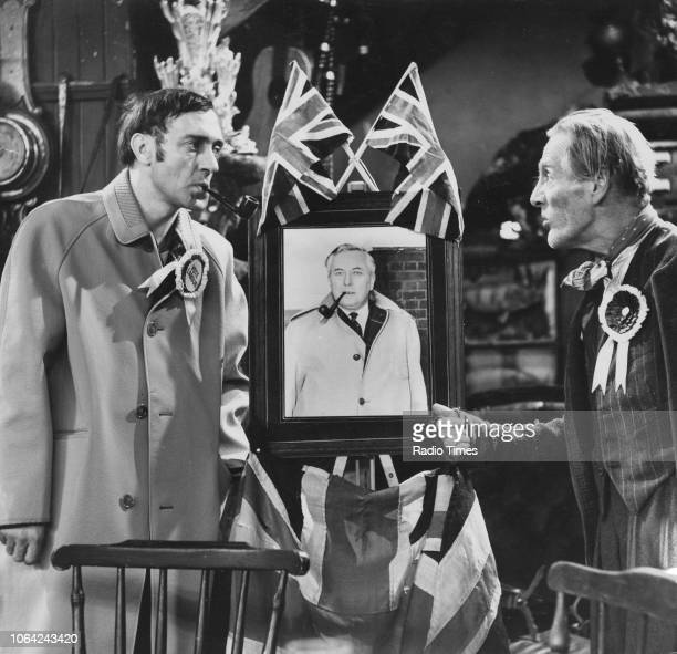 Actors Wilfrid Brambell and Harry H Corbett arguing over a picture of Harold Wilson in a scene from episode 'My Old Man the Tory' of the television...
