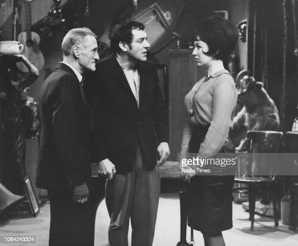Actors Wilfrid Brambell Harry H Corbett and Gwendolyn Watts in a scene from episode 'Steptoe a la Cart' of the television sitcom 'Steptoe and Son'...