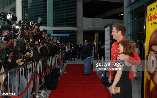 Actors Will Ferrell and Drew Barrymore pose for photographers at the world premiere of Curious George at the ArcLight on January 28 2006 in Hollywood...
