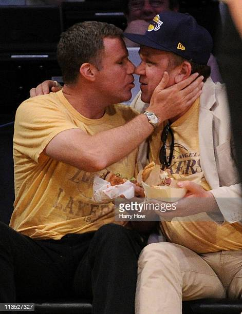 Actors Will Ferrell and John C Reilly kiss during the kiss cam as they sit courtside during Game One of the Western Conference Semifinals in the 2011...
