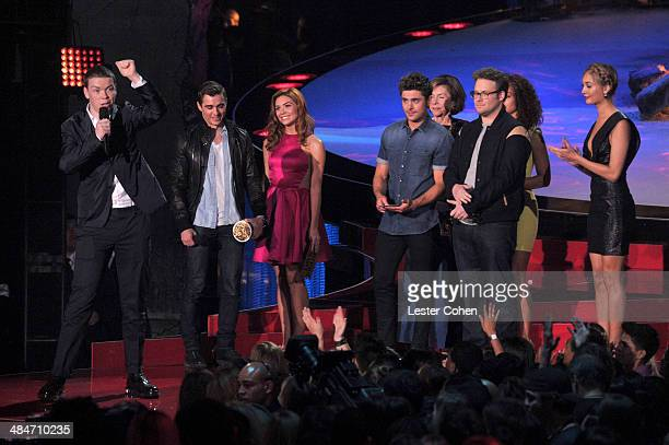 Actors Will Poulter Dave Franco Peyton McCormick Zac Efron Sandra Daubert Seth Rogen and Tiffany Luce speak onstage at the 2014 MTV Movie Awards at...