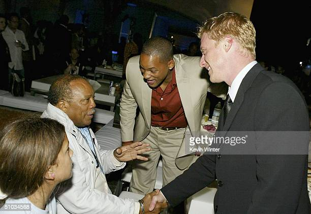 Actors Will Smith and Alan Tudyk talk with music producer Quincy Jones and his daughter Kenya at the afterparty for the premiere of Twentieth Century...
