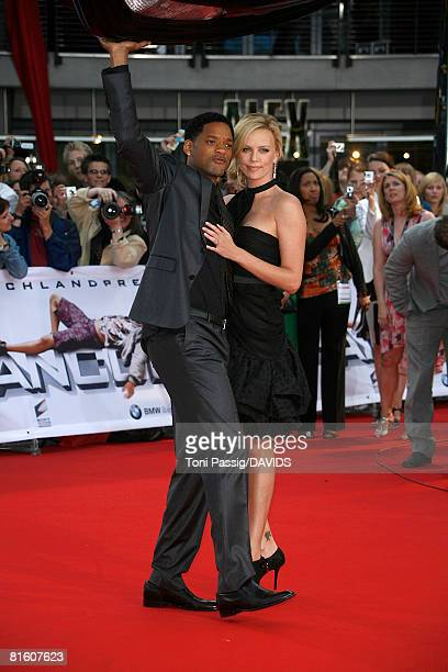 OUT* Actors Will Smith and Charlize Theron attend the 'Hancock' premiere at the Cinestar on June 17 2008 in Berlin Germany