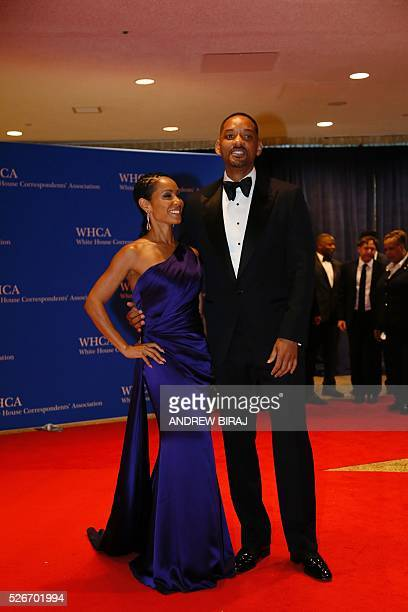 Actors Will Smith and Jada Pinkett Smith arrive for the 102nd White House Correspondents' Association Dinner in Washington DC on April 30 2016 / AFP...