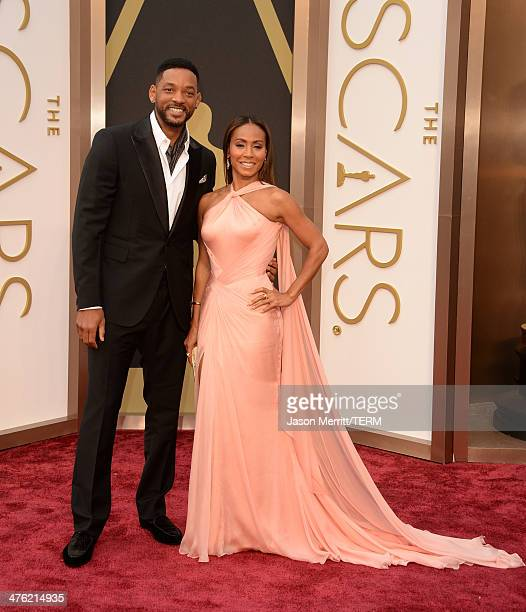 Actors Will Smith and Jada Pinkett Smith attend the Oscars held at Hollywood Highland Center on March 2 2014 in Hollywood California