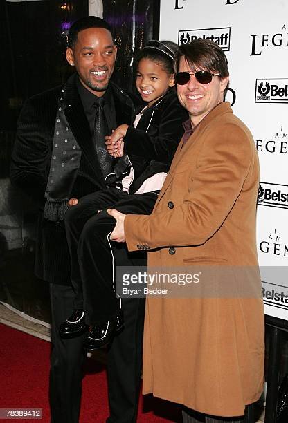 Actors Will Smith and Tom Cruise hold up Willow Smith daughter of actor Will Smith at Warner Brothers' premiere of I Am Legend at The WaMu Theater at...