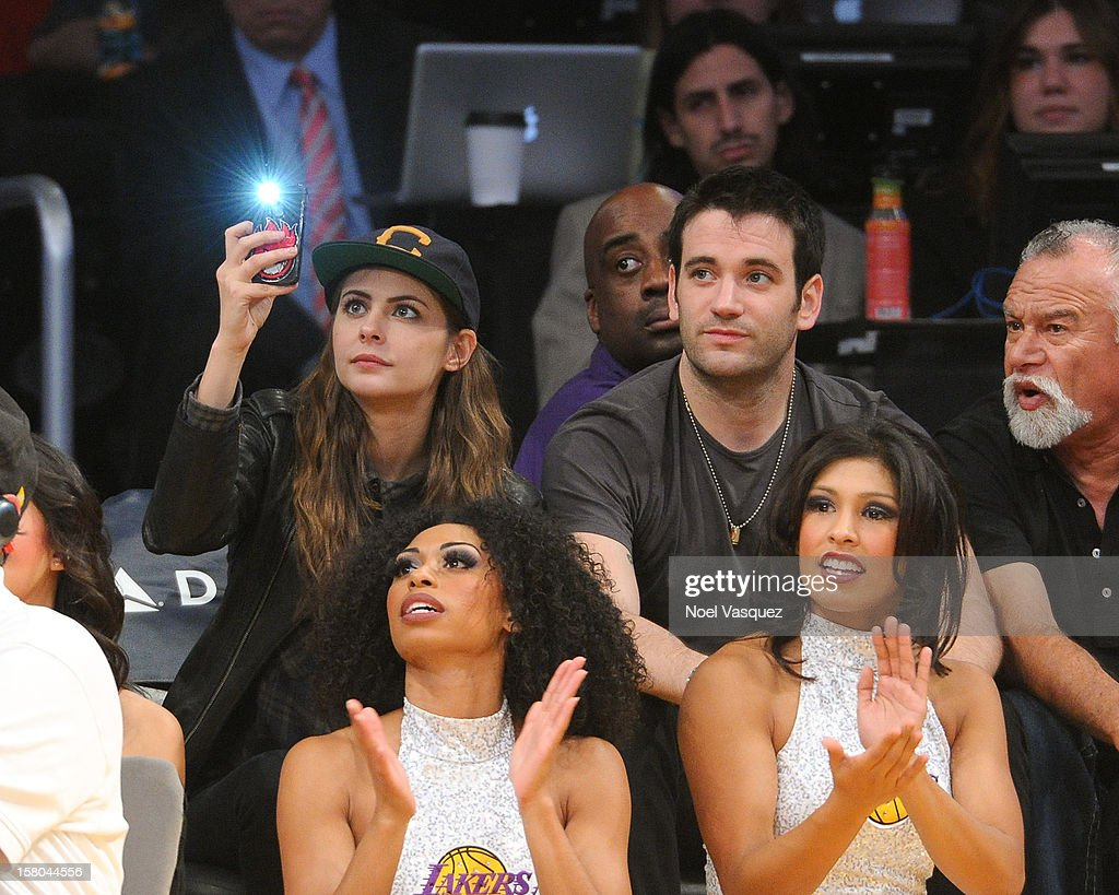 Actors Willa Holland and Colin Donnell attend a basketball game between the Utah Jazz and the Los Angeles Lakers at Staples Center on December 9, 2012 in Los Angeles, California.