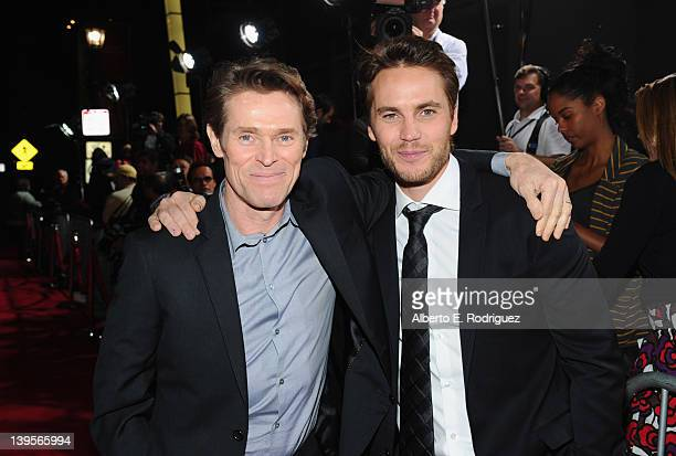 """Actors Willem Dafoe and Taylor Kitsch arrive at the Walt Disney Presents """"John Carter"""" premiere held at Regal Cinemas L.A. Live on February 22, 2012..."""