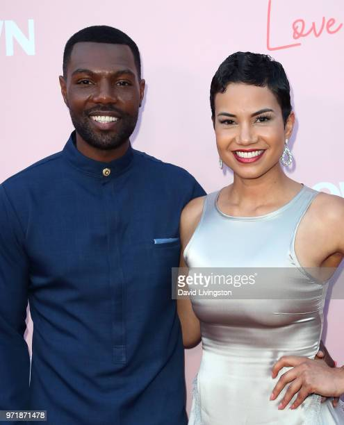 Actors William Catlett and Michele Weaver attend the premiere of OWN's Love Is_ at NeueHouse Hollywood on June 11 2018 in Los Angeles California
