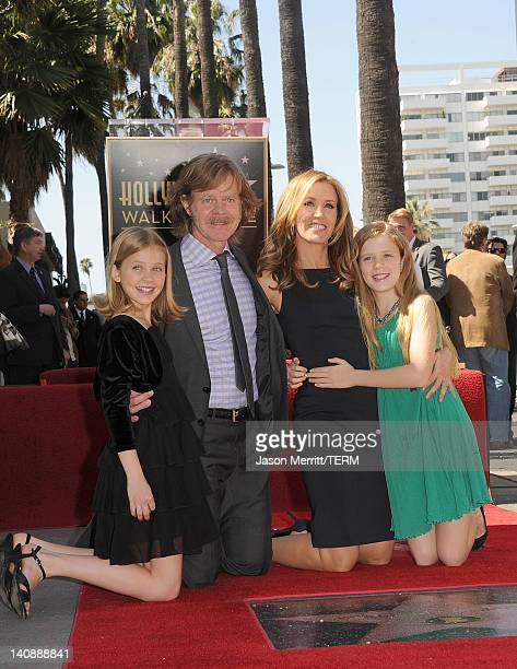 Actors William H Macy and Felicity Huffman pose with there daughters Sophia and Georgia as William H Macy and Felicity Huffman are honored with a...