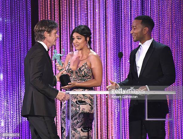 Actors William H Macy Gina Rodriguez and John Legend onstage during the 23rd Annual Screen Actors Guild Awards at The Shrine Expo Hall on January 29...