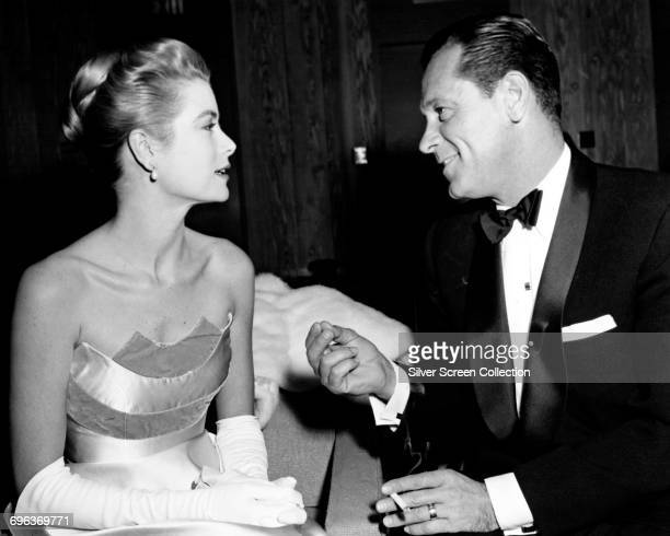 Actors William Holden and Grace Kelly at a party circa 1955