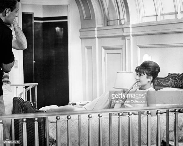 Actors William Holden as Richard Benson and Audrey Hepburn as Gabrielle Simpson on the set of the film 'Paris When It Sizzles' 1964